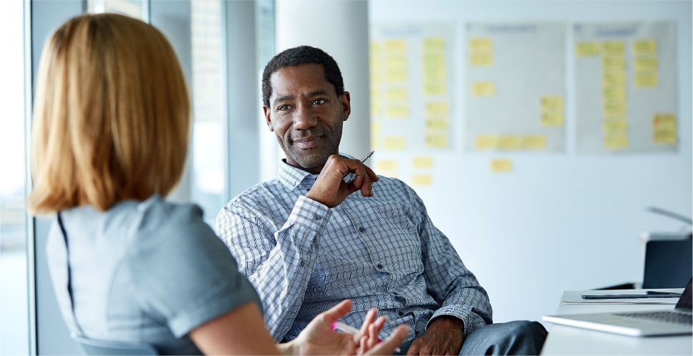 Talent Magnet - A man and a woman are in an interview or business conversation